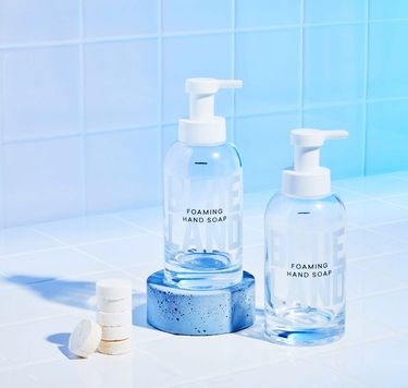 Blueland Hand Soap Duo against white and blue tile: 2 refillable glass bottles, 6 Foaming Hand Soap Tablets