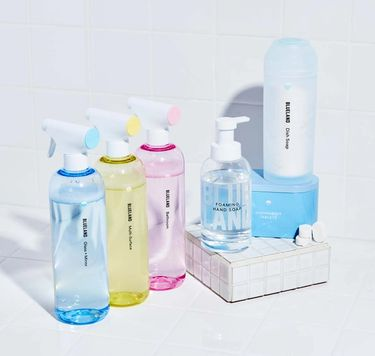 Everyday Clean Kit on white tile: 3 refillable cleaning bottles,1 Foaming Hand Soap, 40 dishwasher tablets, Powder Dish Soap