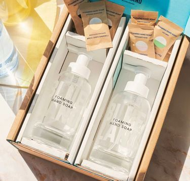 2 glass bottles of foaming hand soap in box with 6 wrapped tablets