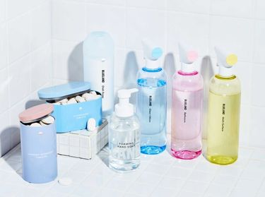 3 refillable cleaning bottles, Foaming Hand Soap, laundry tablets, dishwasher tablets, Powder Dish Soap on white tile