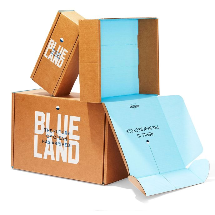 Pile of recyclable Blueland cardboard boxes: 2 boxes stacked on a third with one lid open