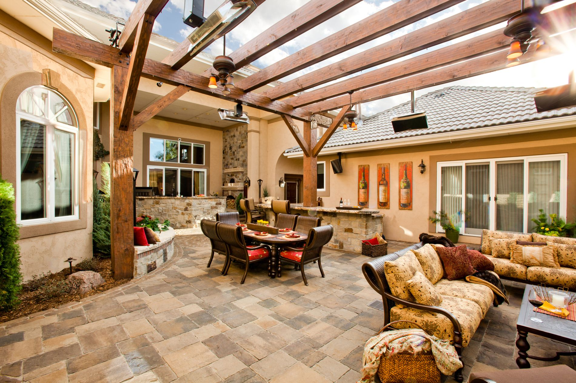 Paver courtyard with pergola covering outdoor living space