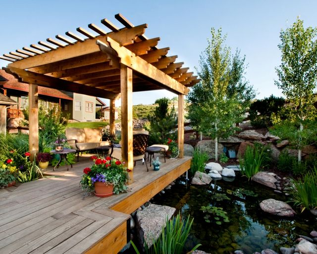 Deck next to pond with pergola