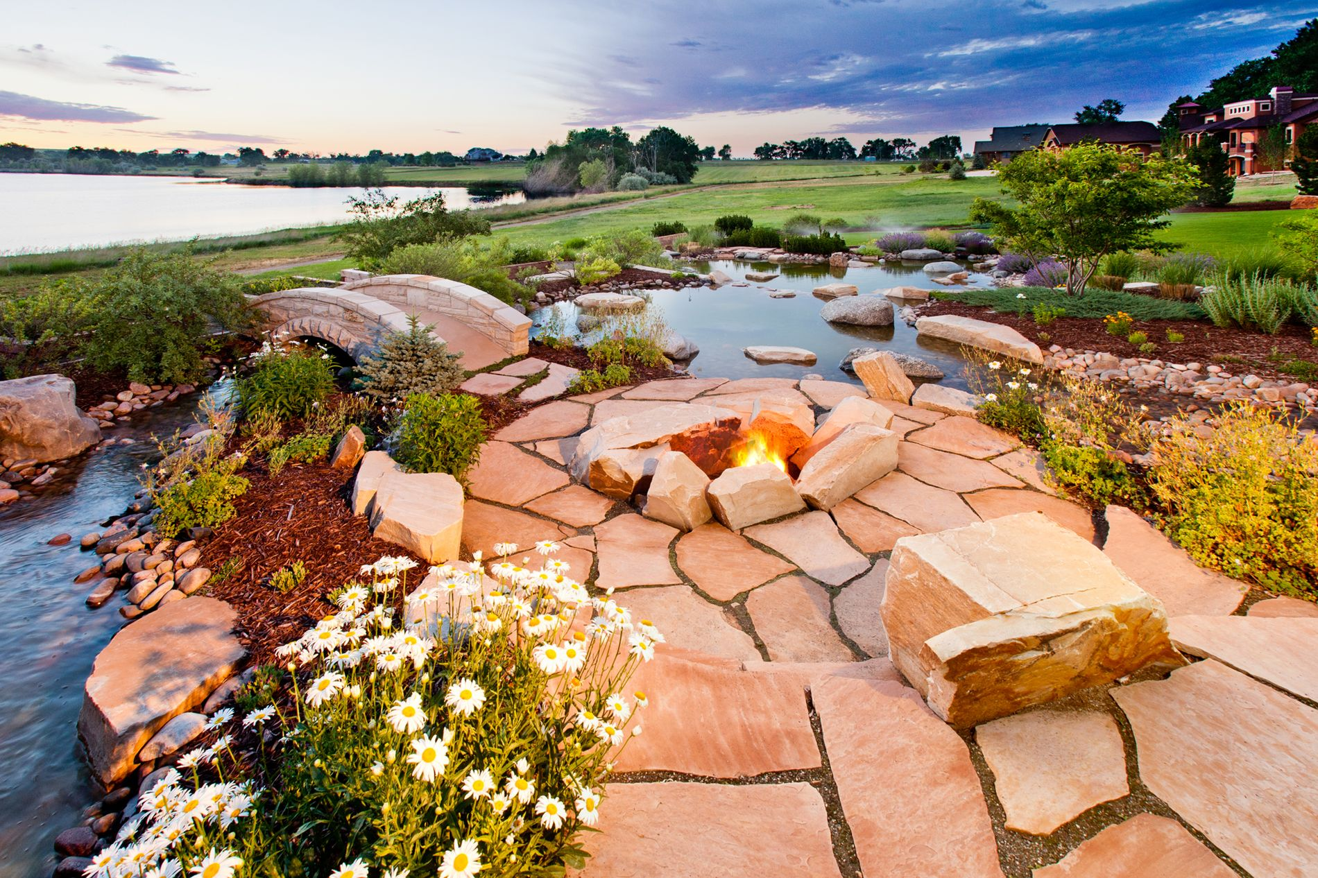 Wood burning fire pit with water feature and masonry bridges