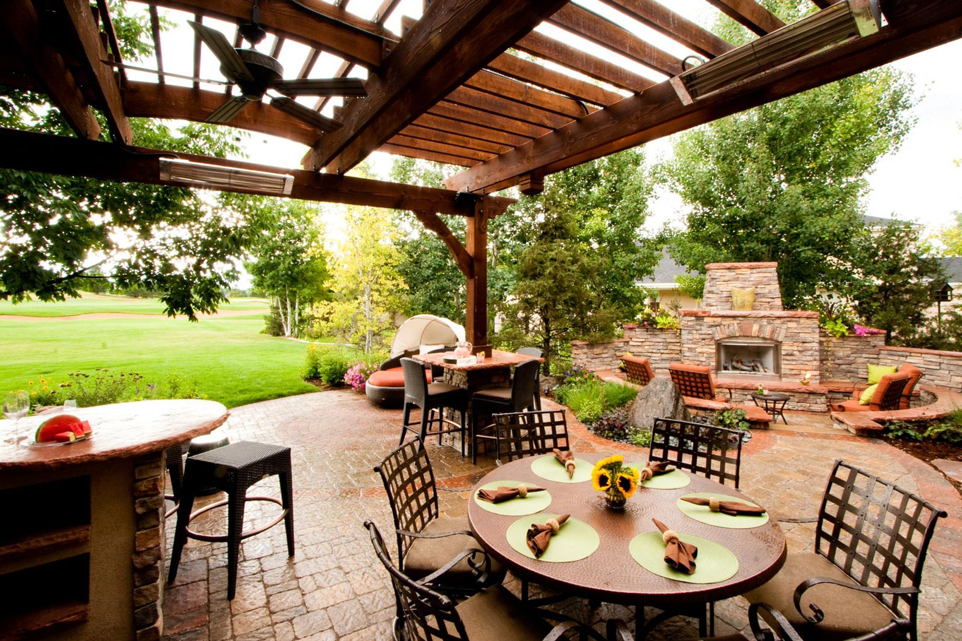 Outdoor Fireplace With Paver Patio and Shade Structure