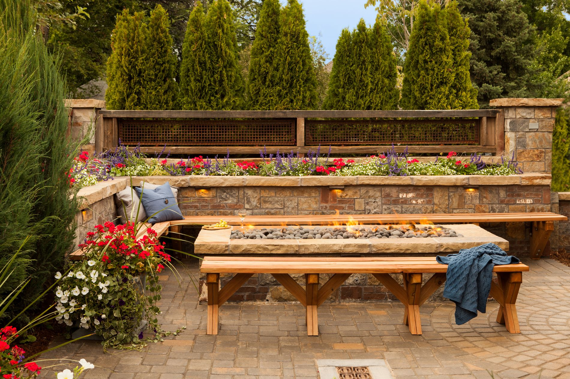 Long rectangle fire pit with custom masonry benches