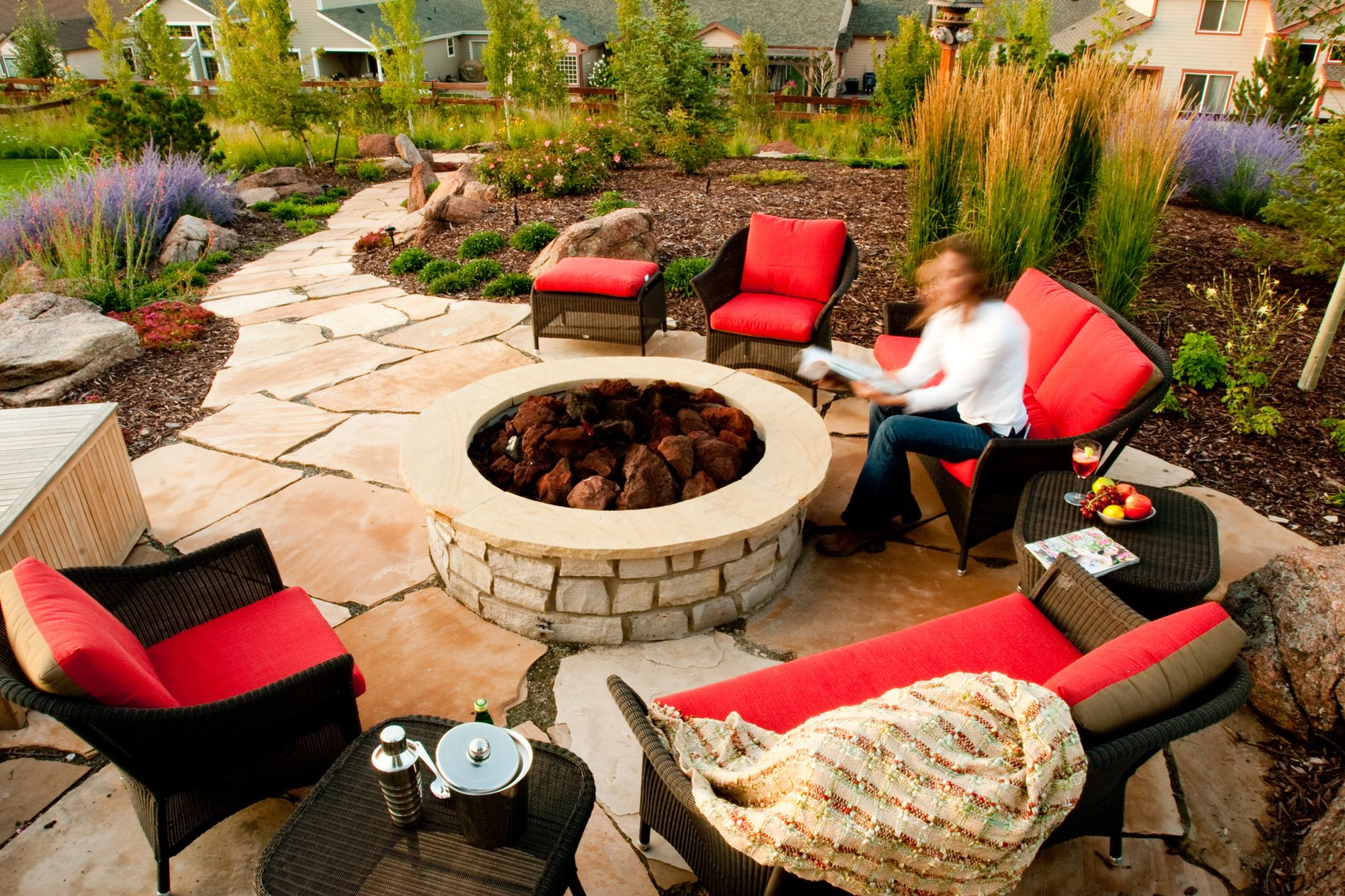 Round fire pit with flagstone patio