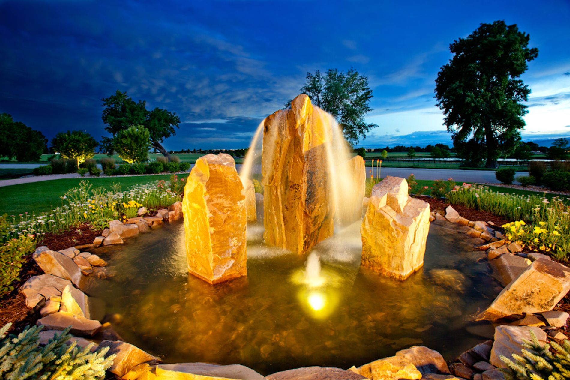 Large cored boulder water feature made with sandstone