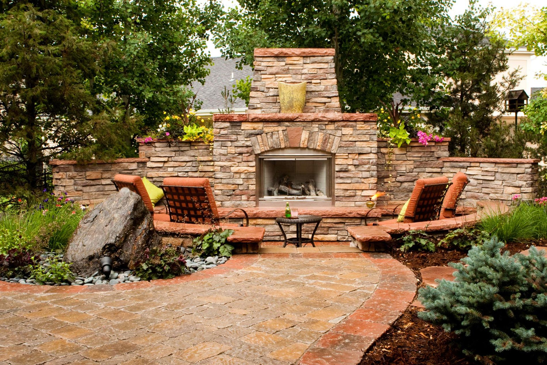 Masonry Outdoor Fireplace And Cored Boulder Water Feature