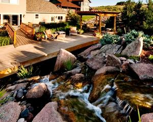 Water feature with deck and shade structure