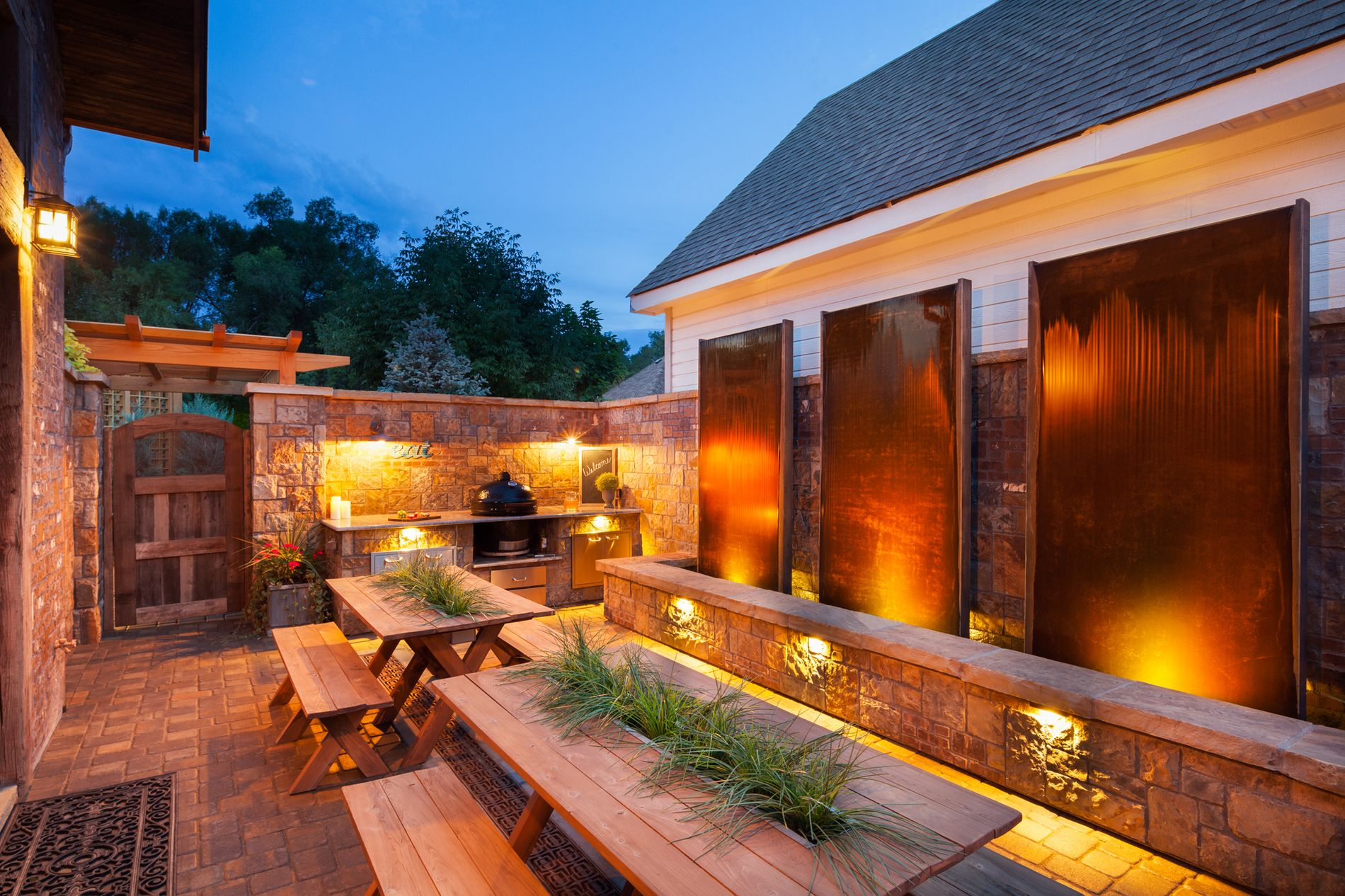Hardscape lighting illuminates water features and masonry