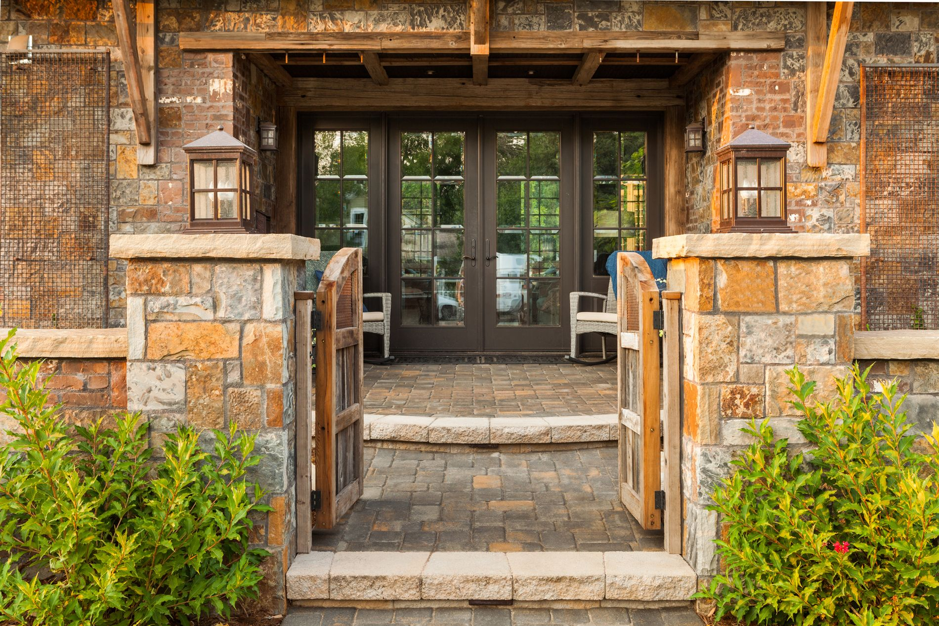 Paver front entrance with steps to front porch