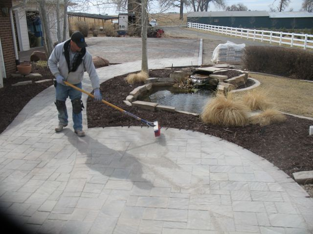 Installing Poly Sand on our new office patio