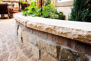 Masonry seat wall with paver patio