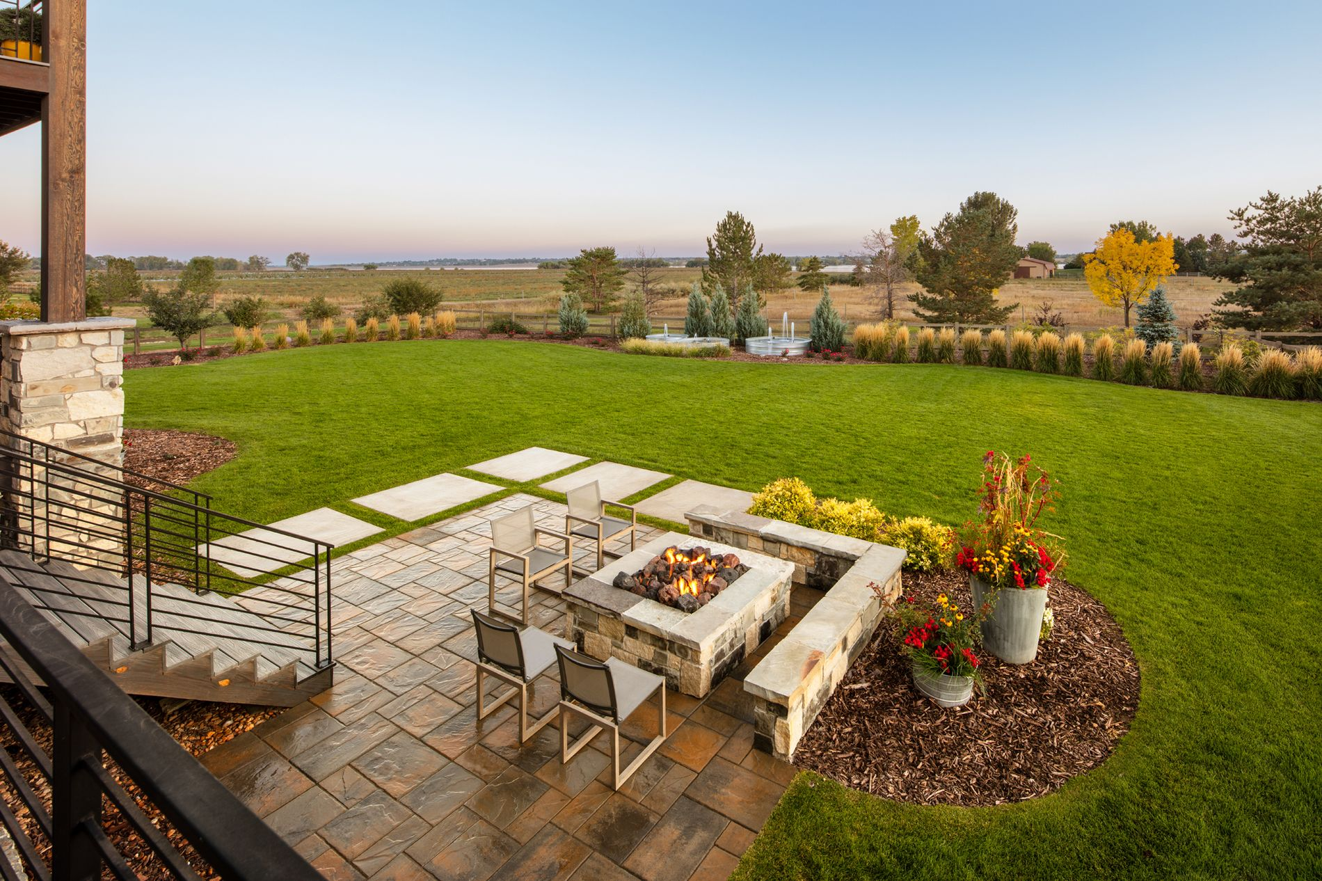 Paver patio with fire pit and seat wall