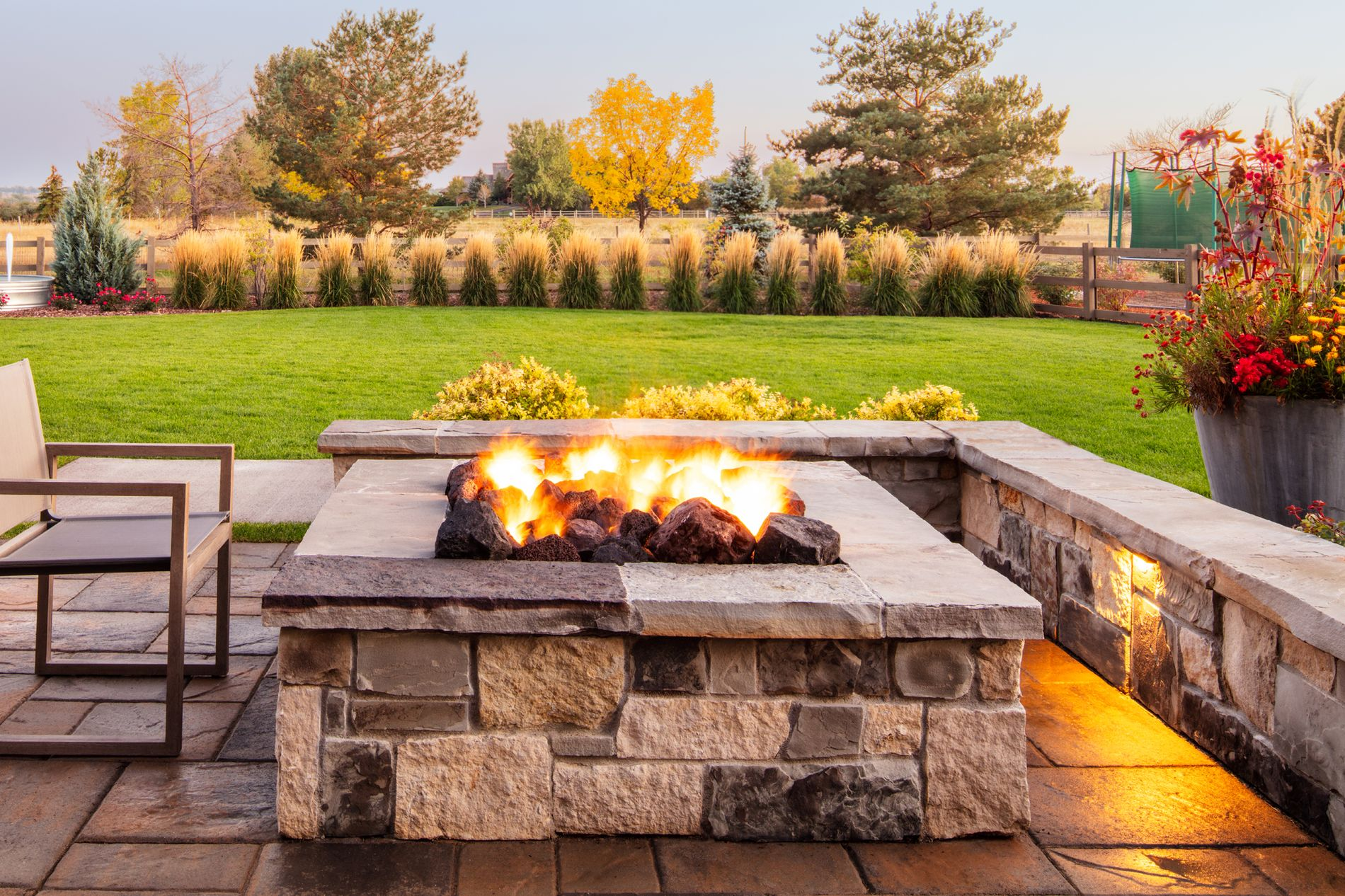 Square fire pit with seat wall and paver patio