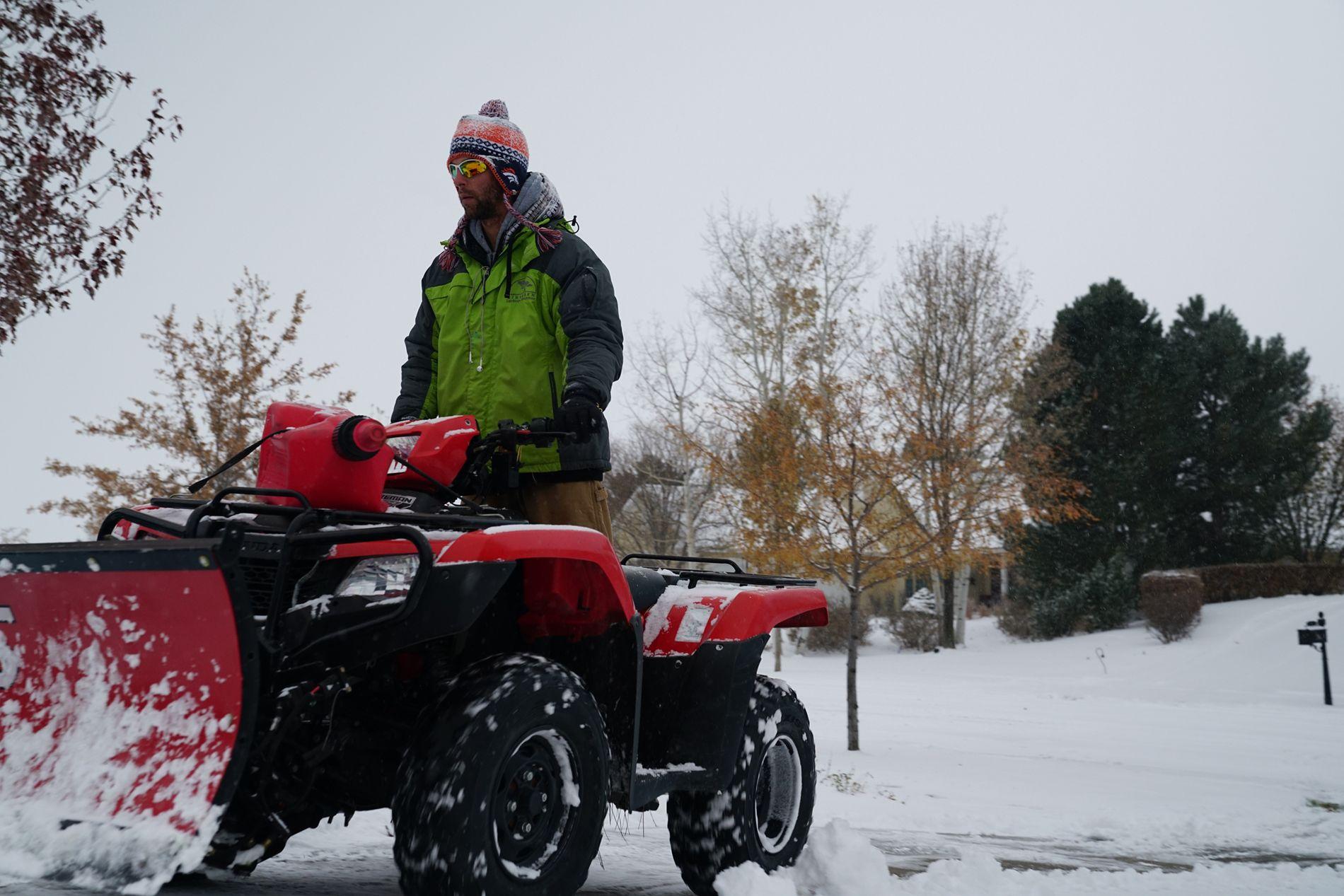 ATV plowing snow
