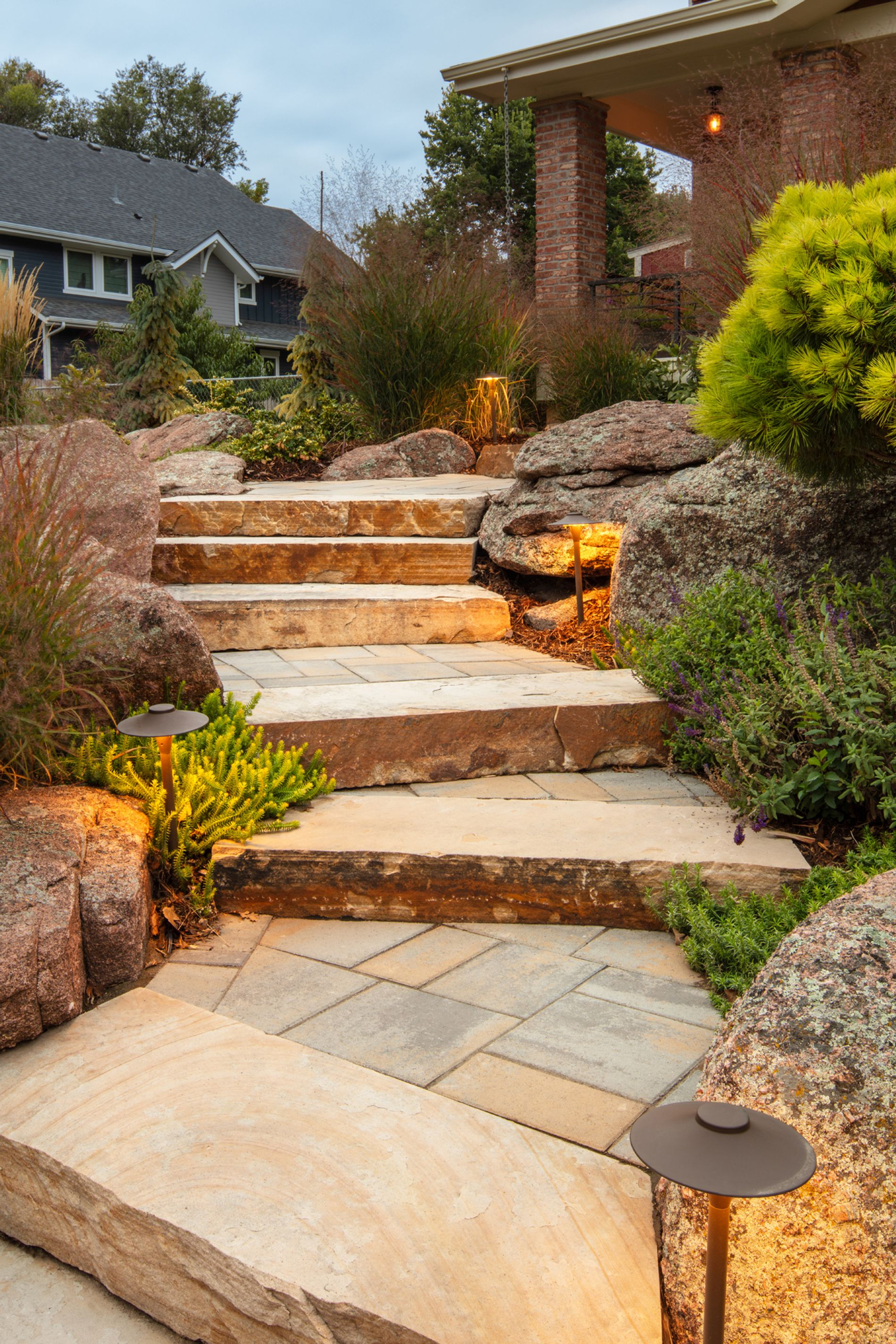 Path lights illuminate sandstone staircase