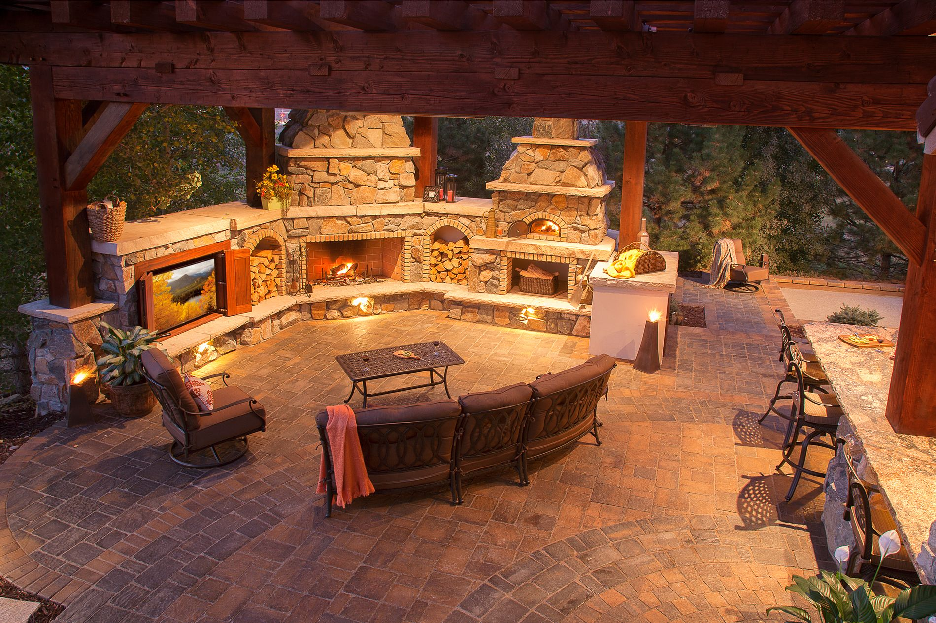 Outdoor fireplace, pizza oven, kitchen, and theater, with paver patios