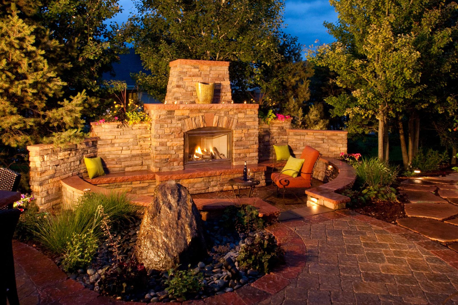 Outdoor Fireplace and Water Feature with Landscape Lights