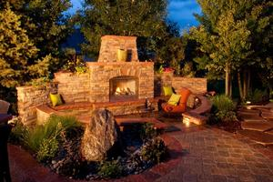 Outdoor fireplace with sunken paver patio