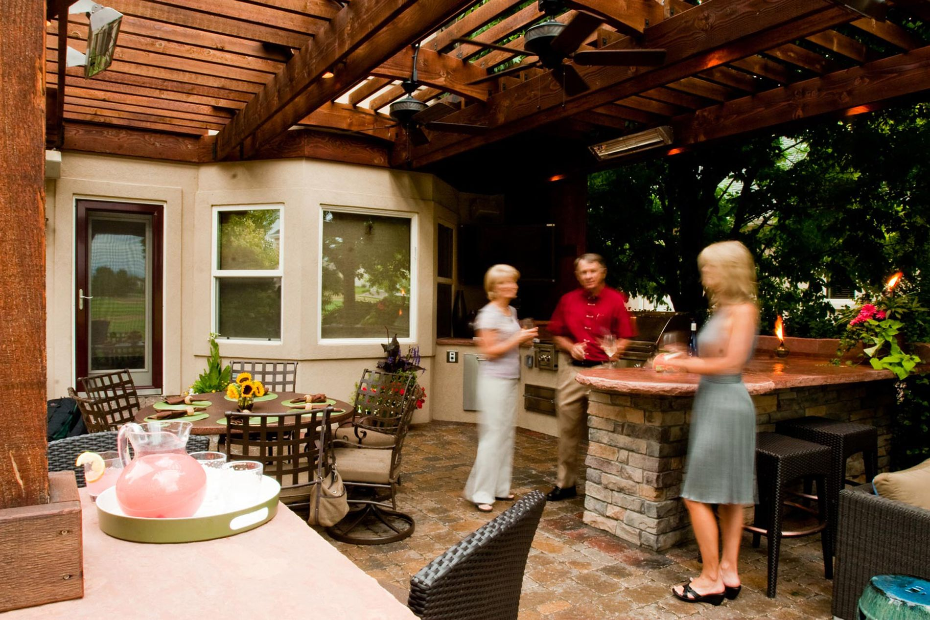 Outdoor Kitchen With Paver Patio and Shade Structure