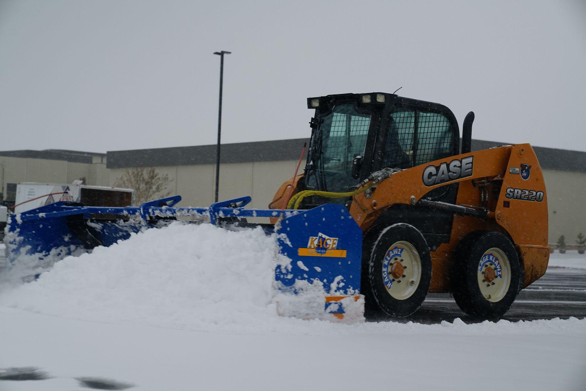 Skid loader and push box moving snow