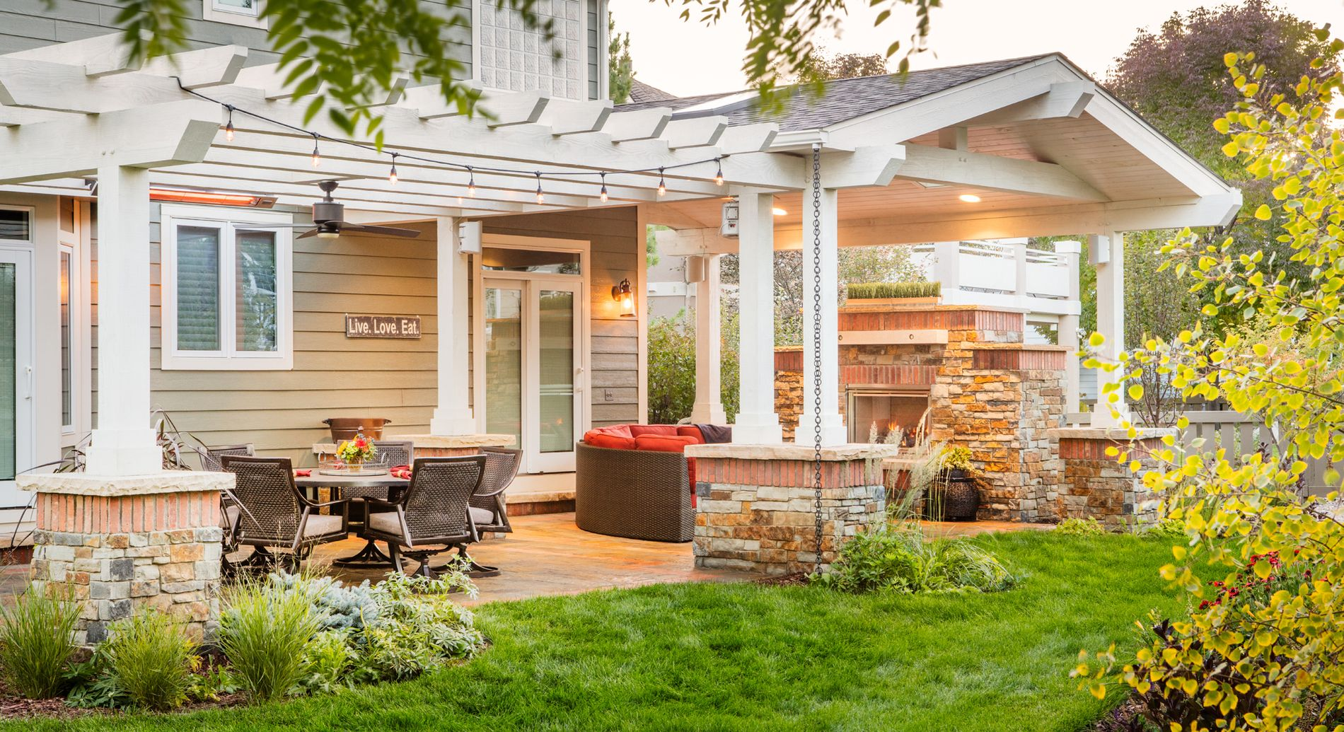 White gable roof with pergola covering an outdoor living space