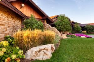 Landscape beds with ornamental boulders and plantings