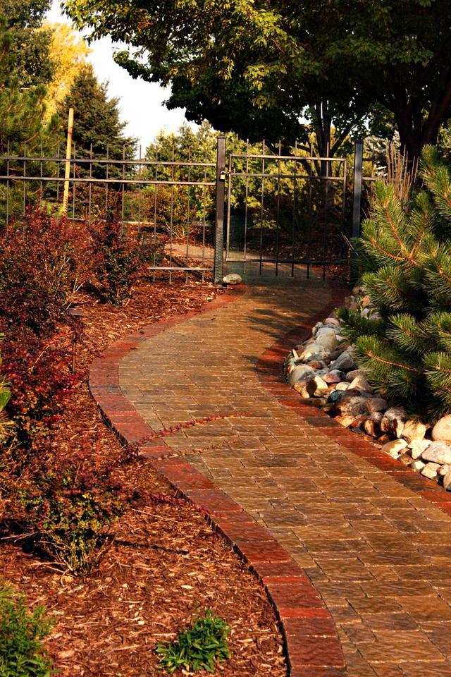 Paver Sidewalk with Iron Gate