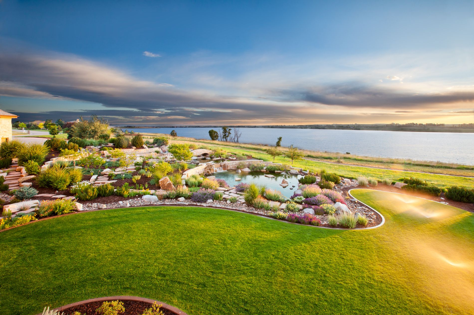 Lake Front Estate Landscaping with Water Feature