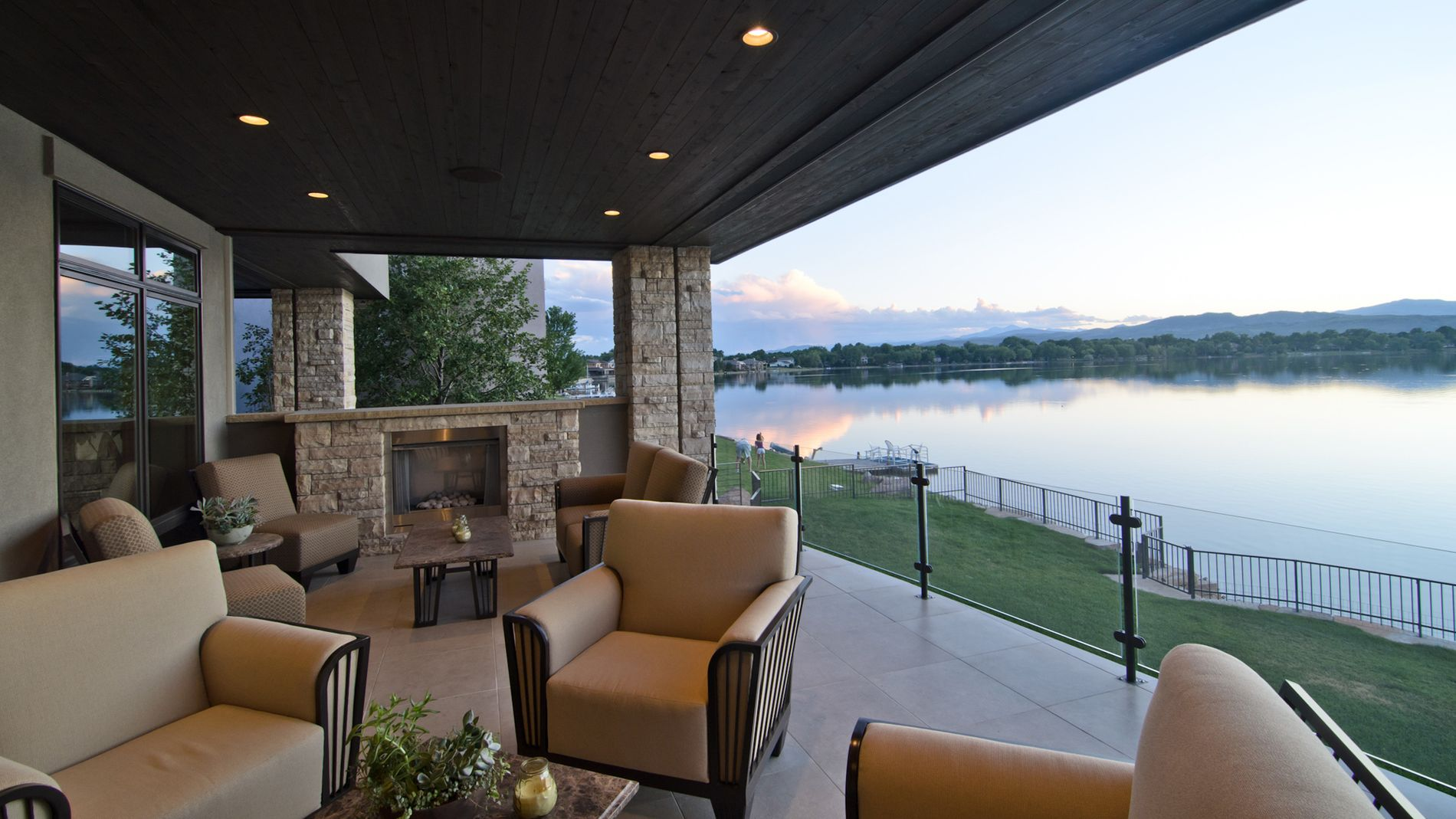 Outdoor living deck with landscape and lake views
