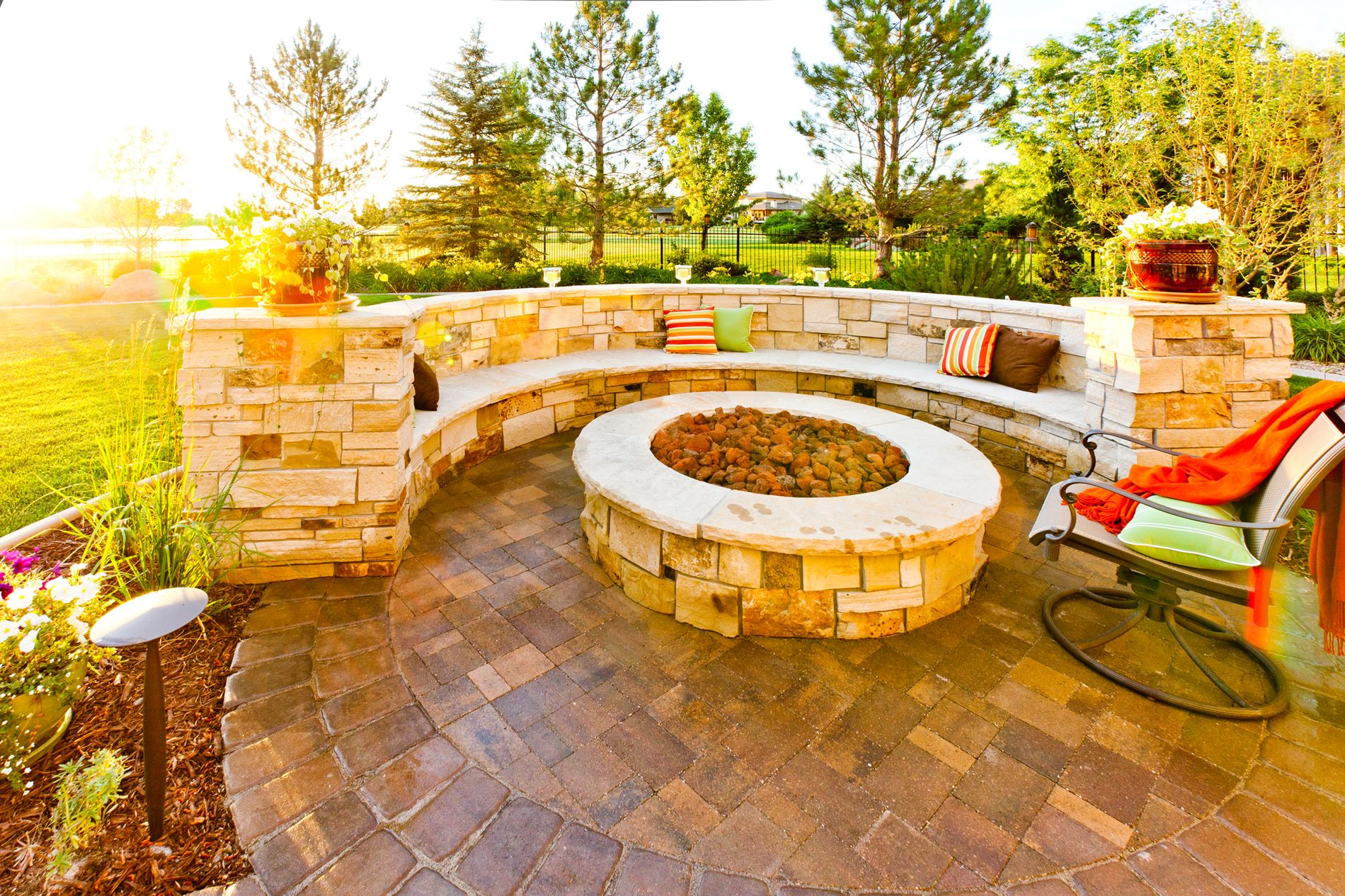 Circular gas fire pit with custom masonry seat wall