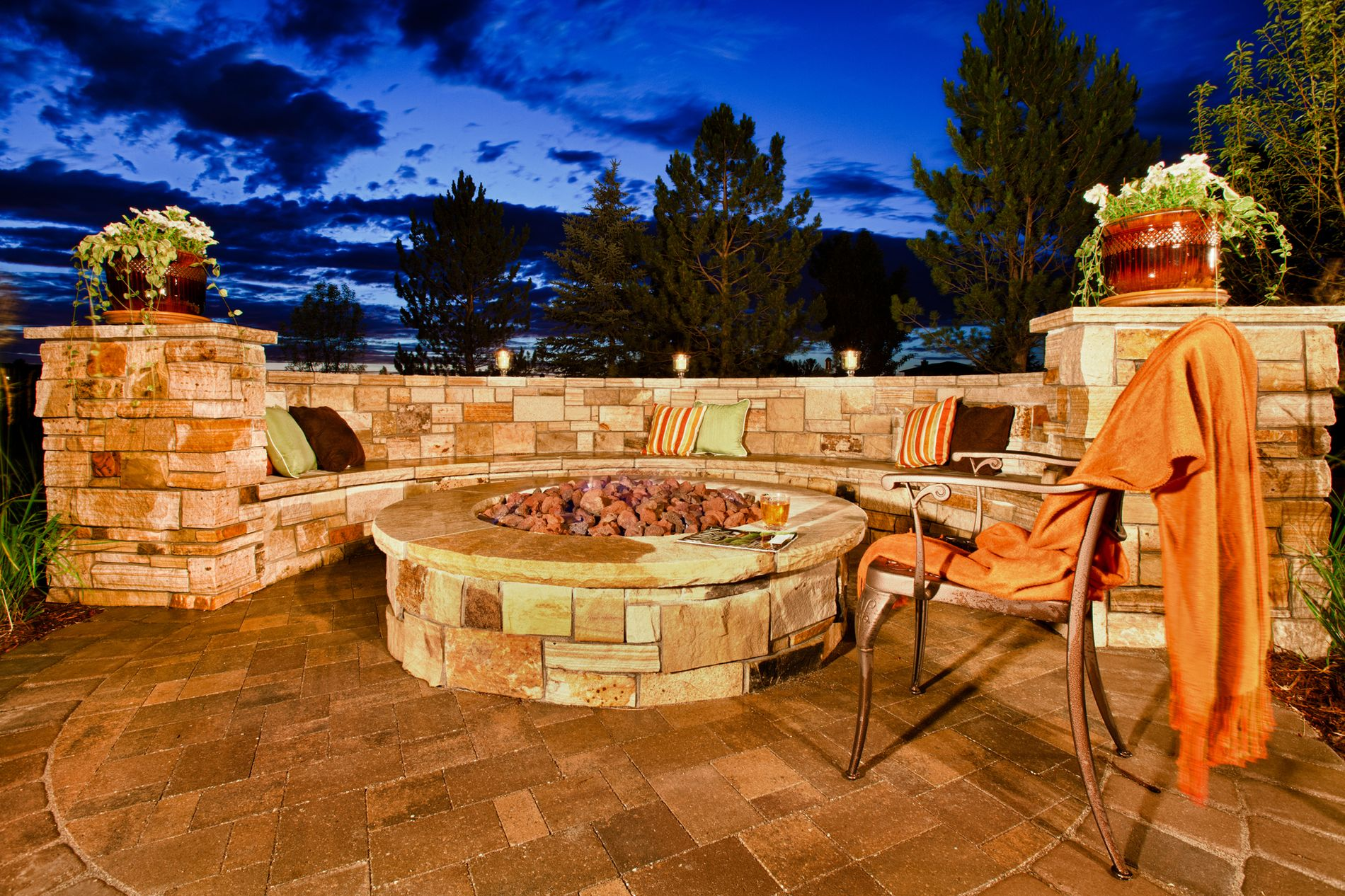 Fire Pit at Night with Masonry Seating