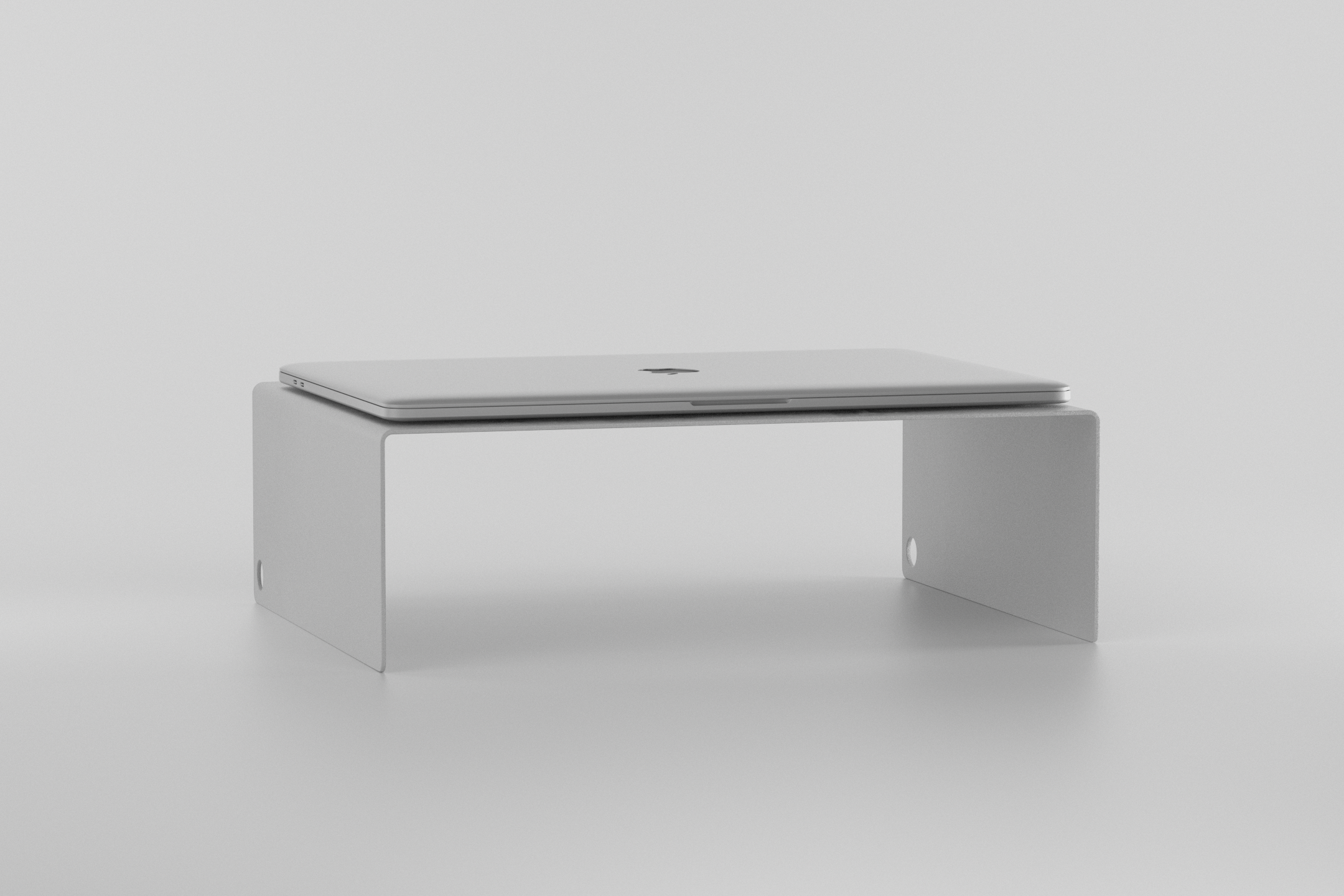 The Laptop Stand - light grey with laptop on it