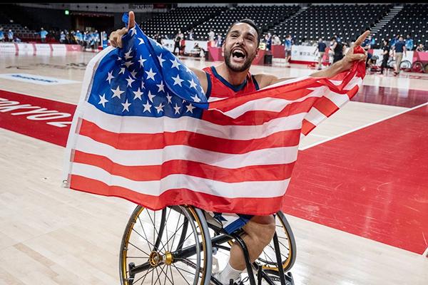 jorge sanchez holding up american flag   jorge sanchez