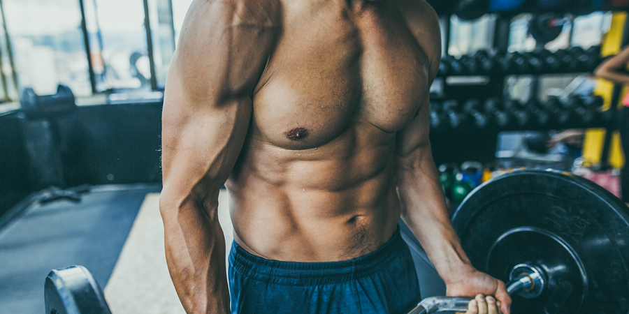 shirtless man doing curls   how to get more vascular