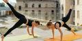 two women doing yoga   yoga for athletes