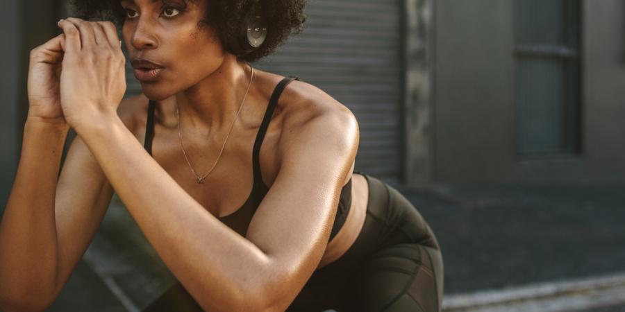 woman doing bodyweight squat | squat depth