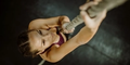 woman climbing a rope   grip strength