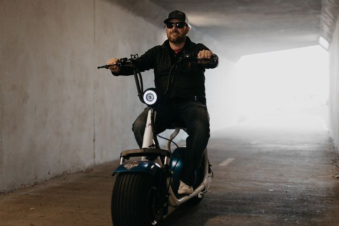 Bobby Corrales riding phat tire scooter in a tunnel