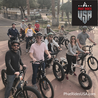 Group of people enjoying electric bike riding