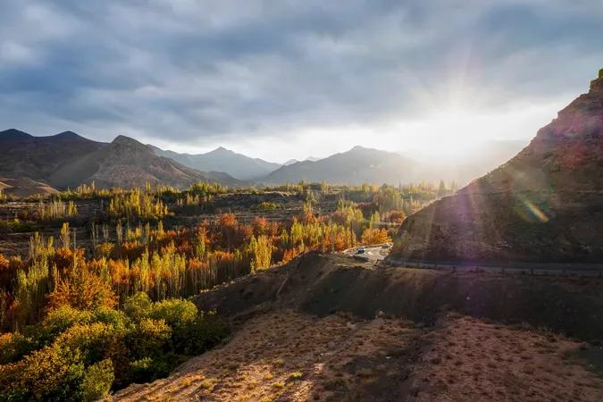 Sun rays over hills