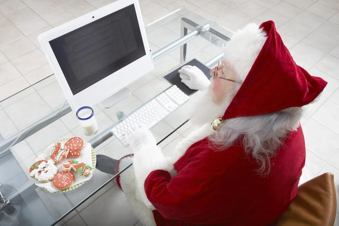 Santa Claus using his computer