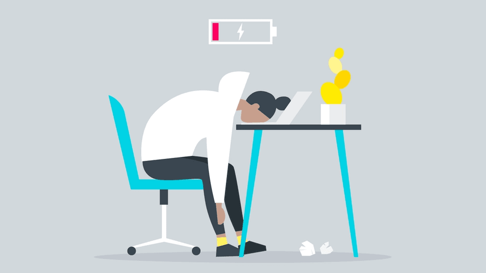 Illustration of employee at desk experiencing burnout