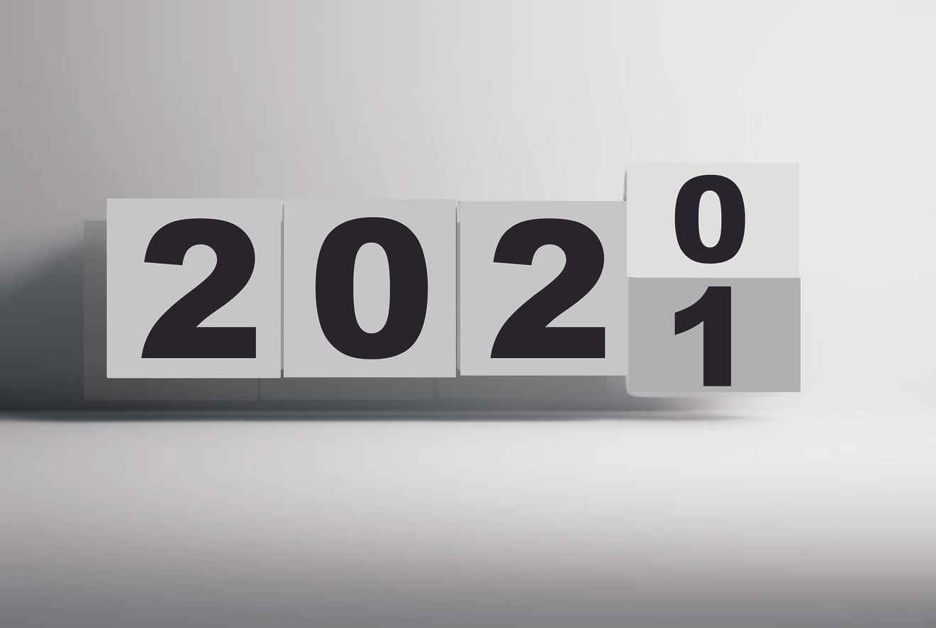 Photo of a calendar flipping over from 2020 to 2021