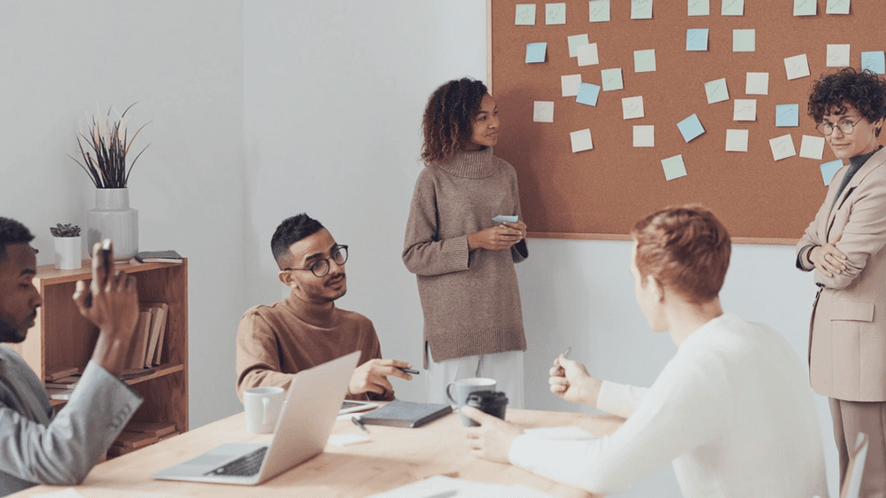 Synchronous team meeting; Photo by fauxels from Pexels
