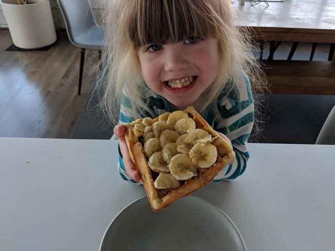 Kid eating amazing belgian waffles