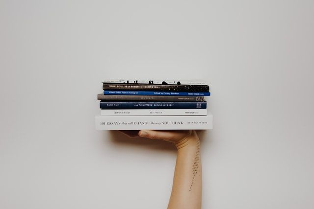 Stack of books - book club - image - She Mentors