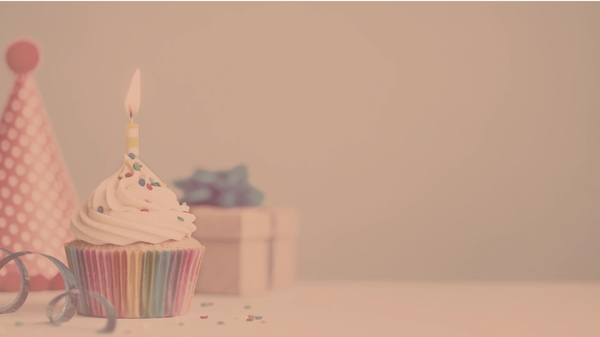 Photo of a cupcake, present, and birthday hat
